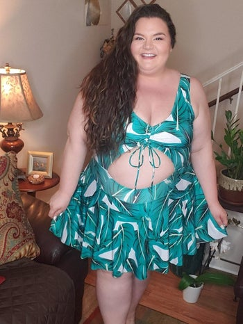 image of reviewer wearing the green esprilia floral tankini in a size 5XL