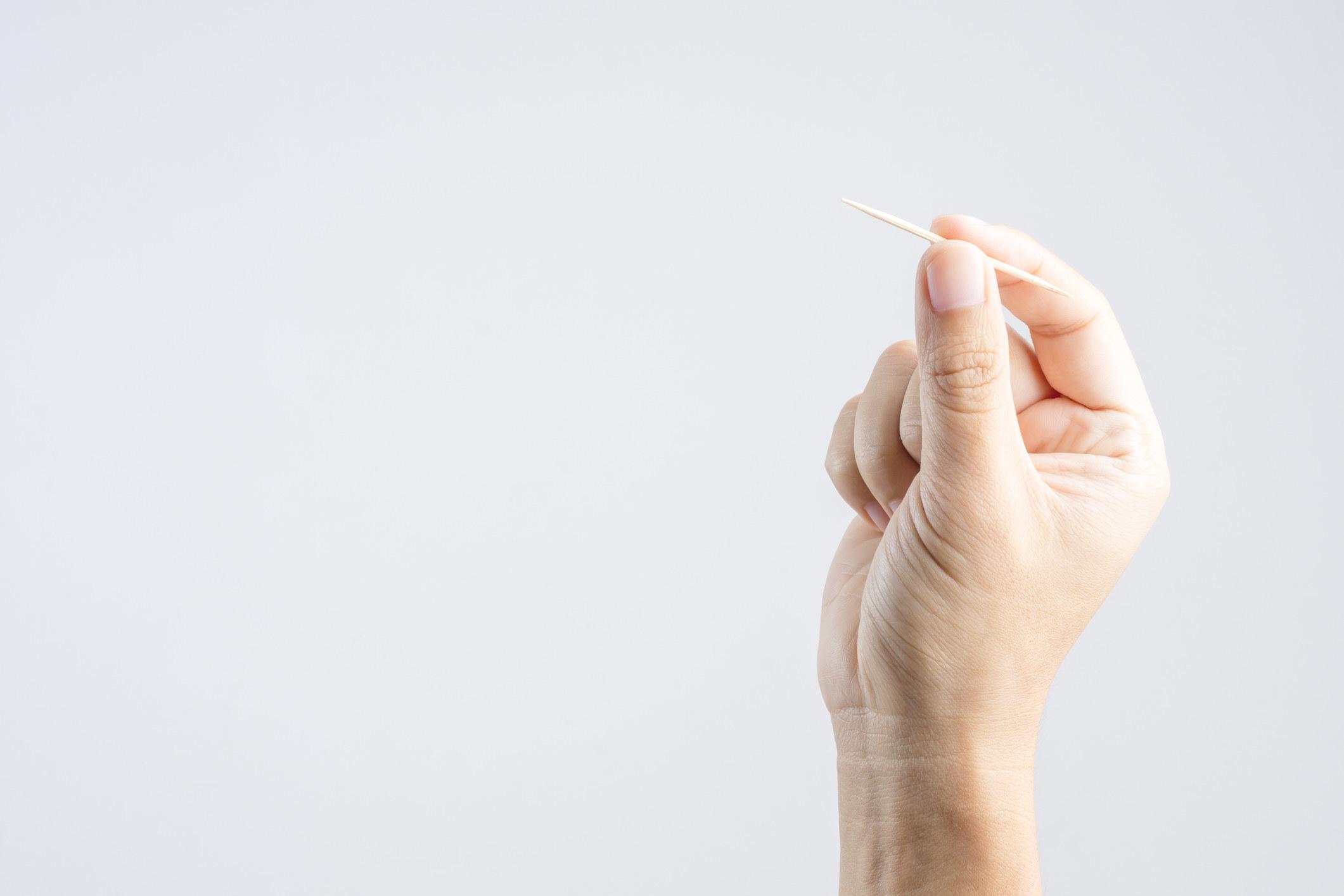 hand holds toothpick