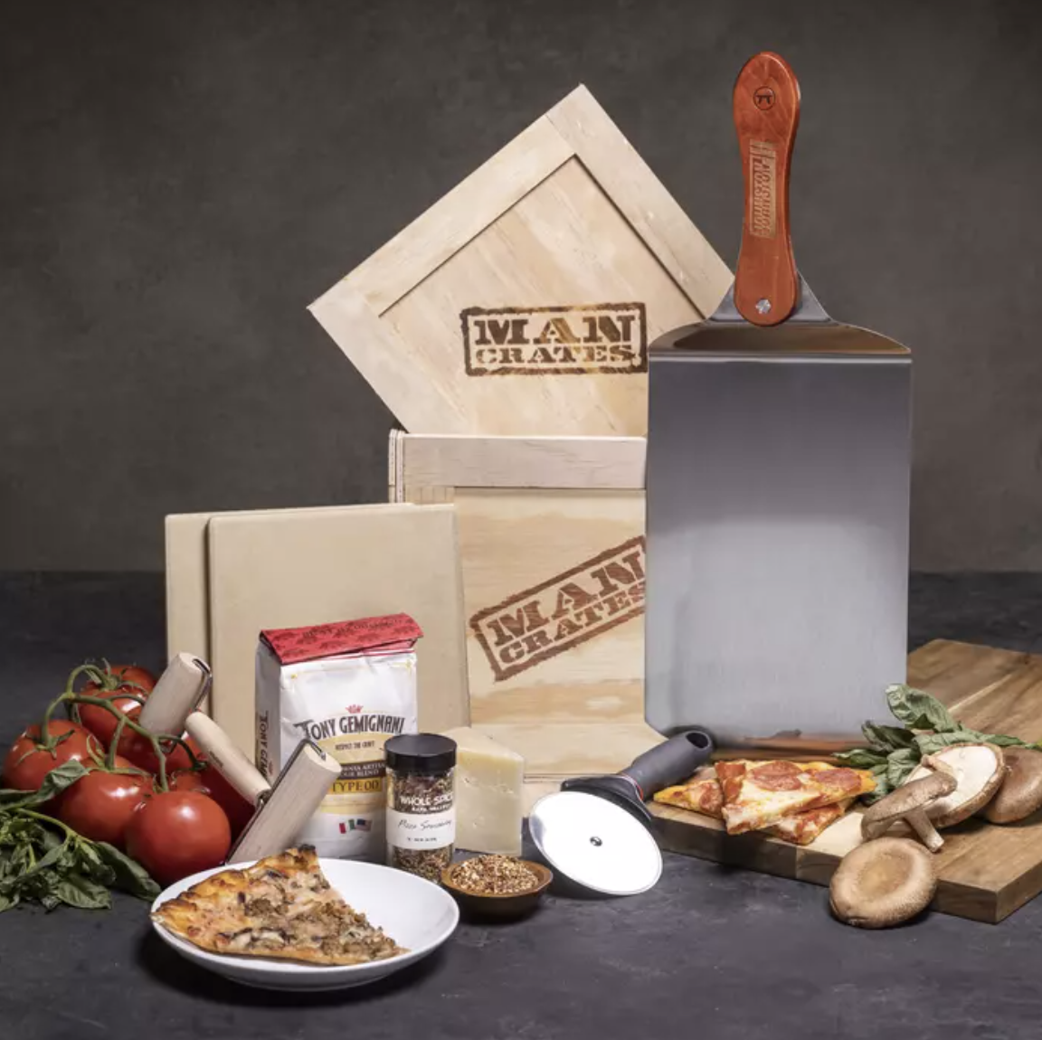 the wood crate with all that's included and random pizza and ingredients around it