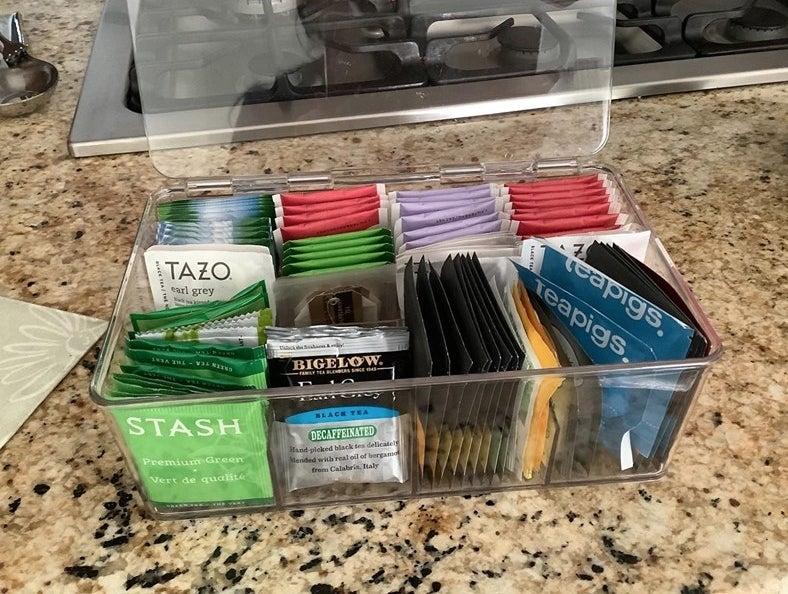 clear organizer holding tea
