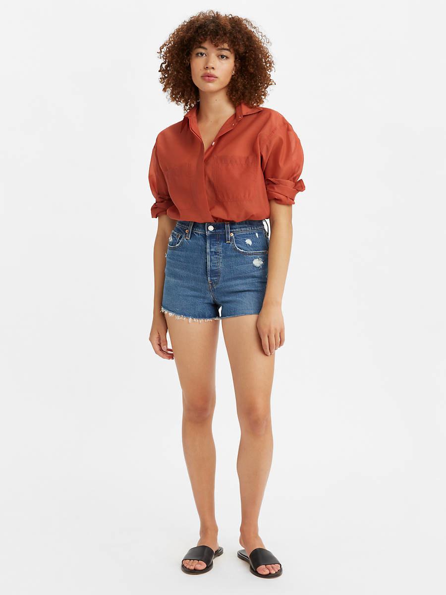 model in medium wash jean shorts