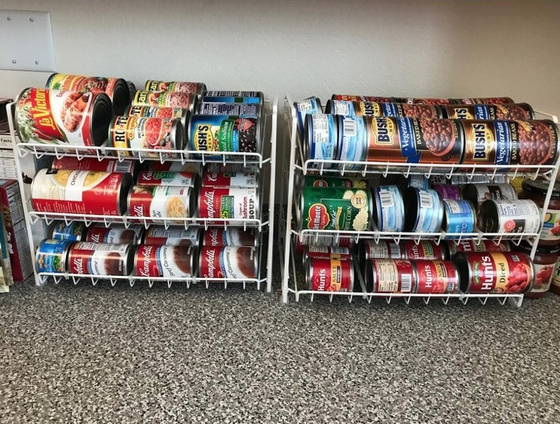 A white can organizer, full of colorful cans