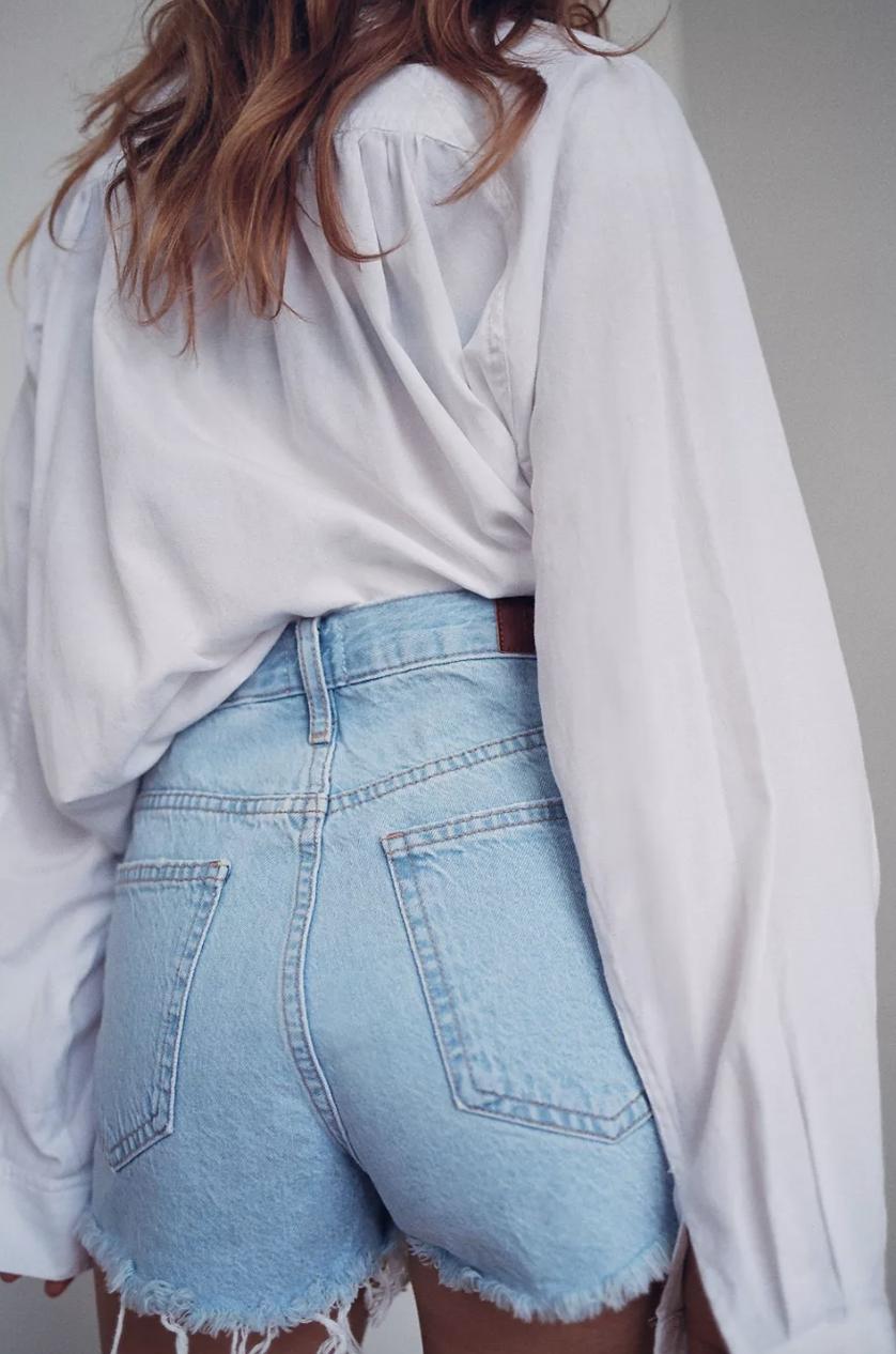 model wearing denim shorts