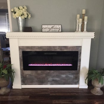 reviewer's electric fireplace installed in a mantel