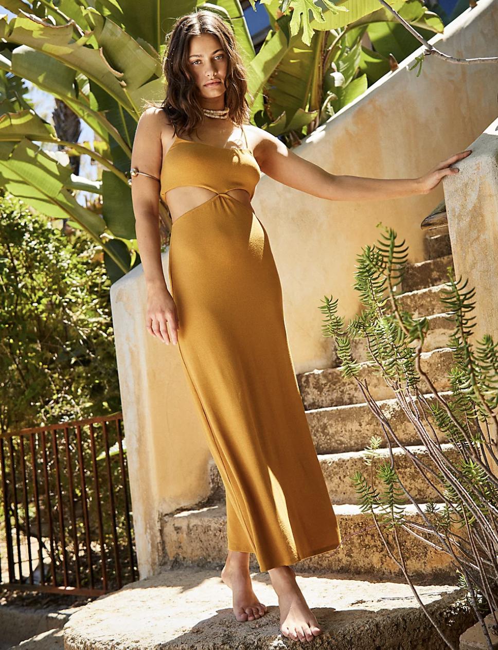 model wearing the cutout midi dress