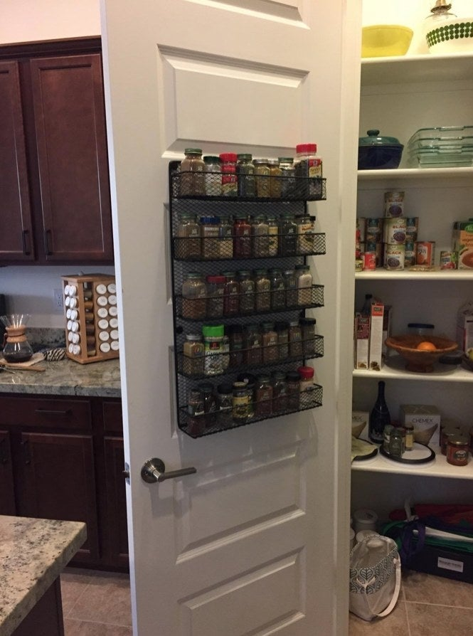 A over the wall spice rack, filled with colorful spices