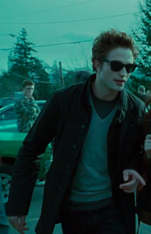 Edward wearing pants, a shirt, a sweater, a jacket, and sunglasses
