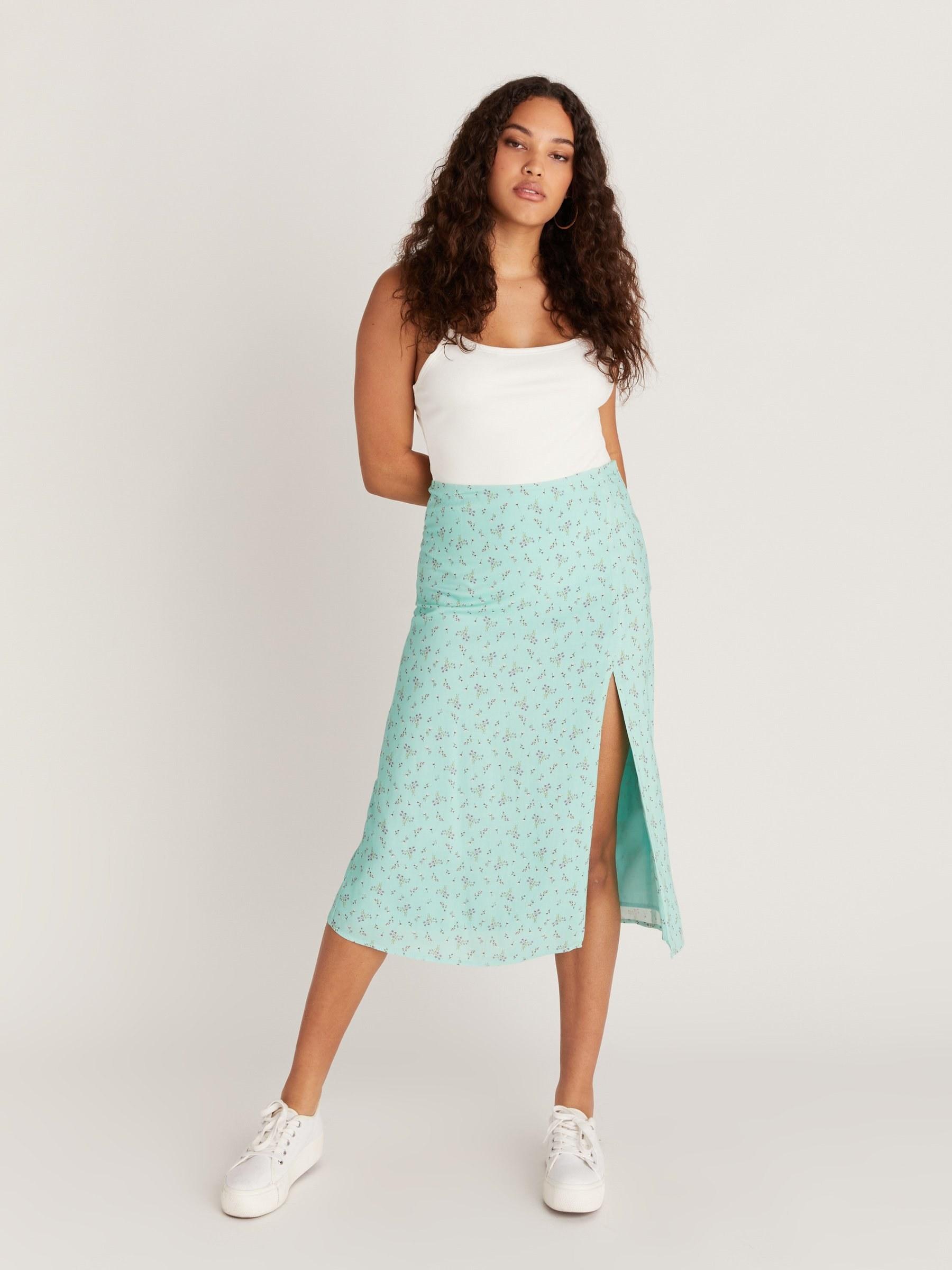 model wearing green floral skirt
