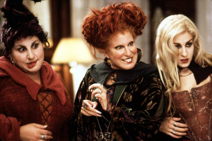The three witches mischievously look at something