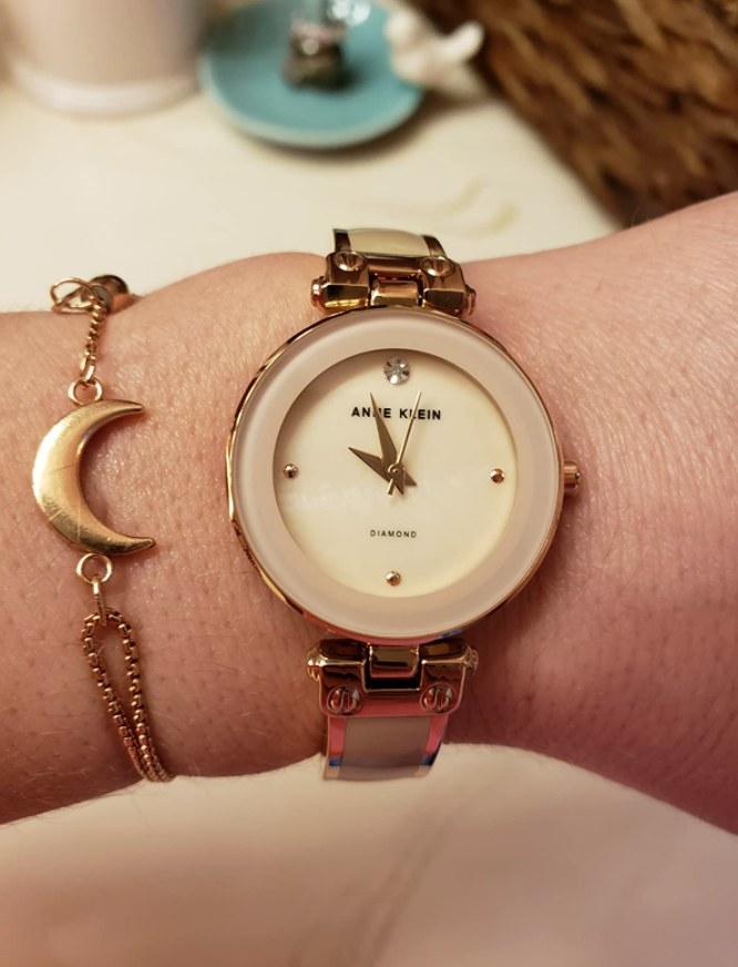 A reviewer wearing the watch in pink