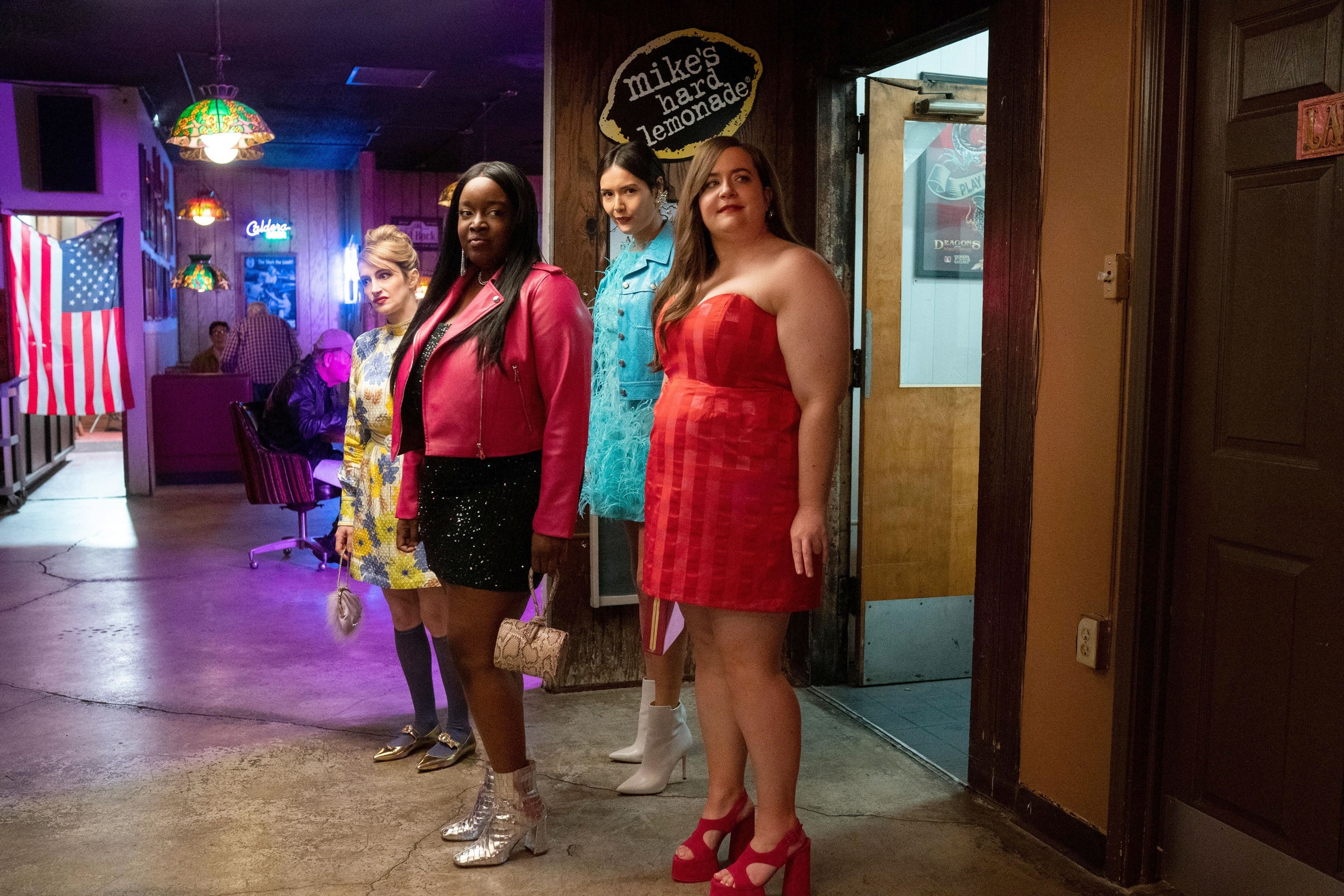 The cast of Shrill in a bar