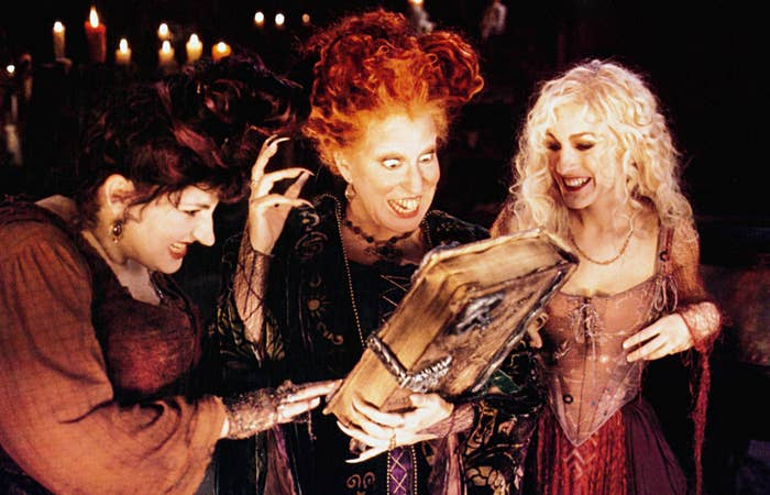 The witches look at a large book