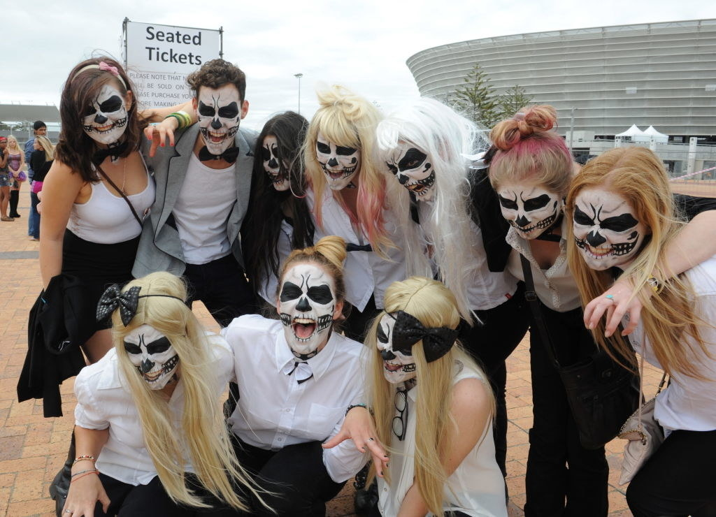 A bunch of fans in skull makeup at the Born This Way ball