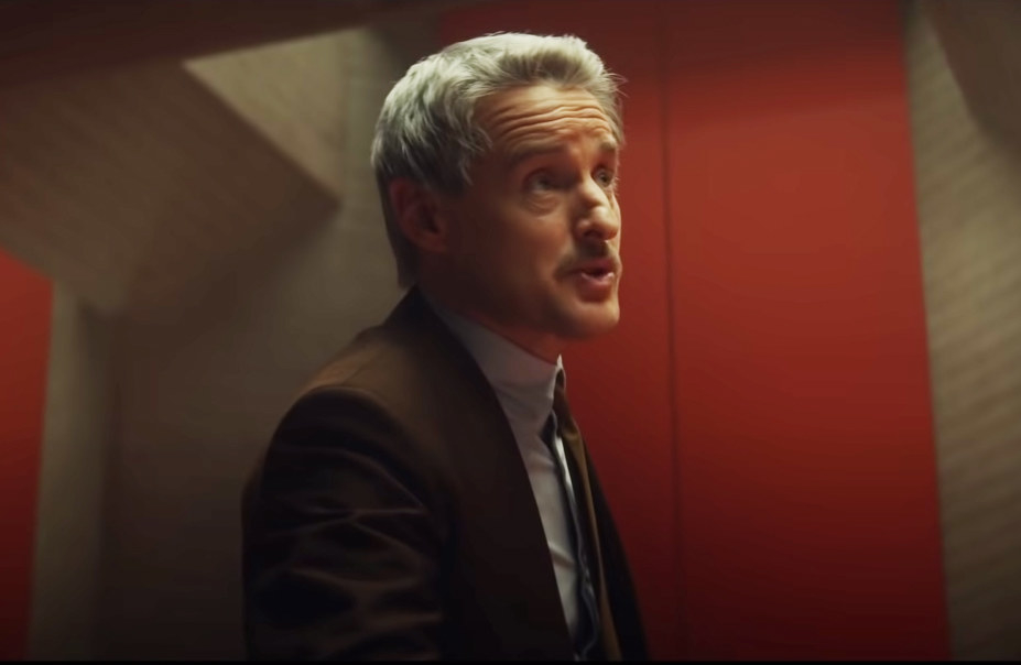 Owen in a scene as Mobius, a TVA agent
