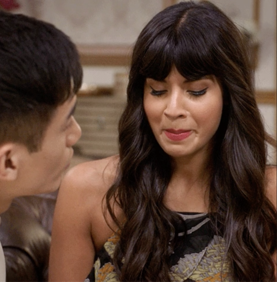 Jameela Jamil trying not to laugh