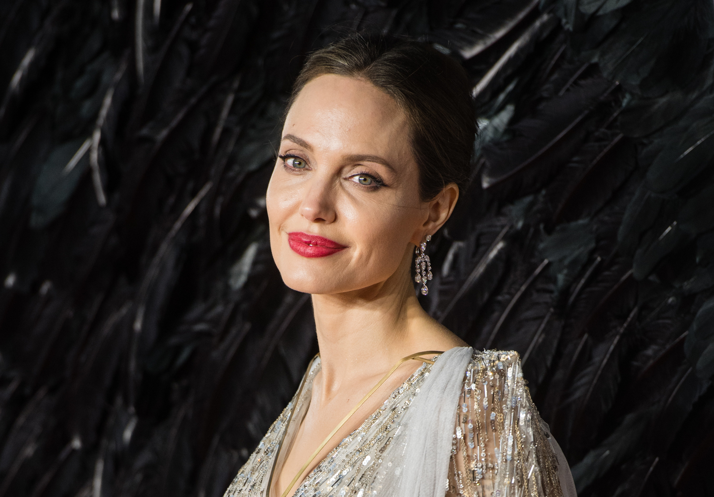 Angelina smiles on a red carpet