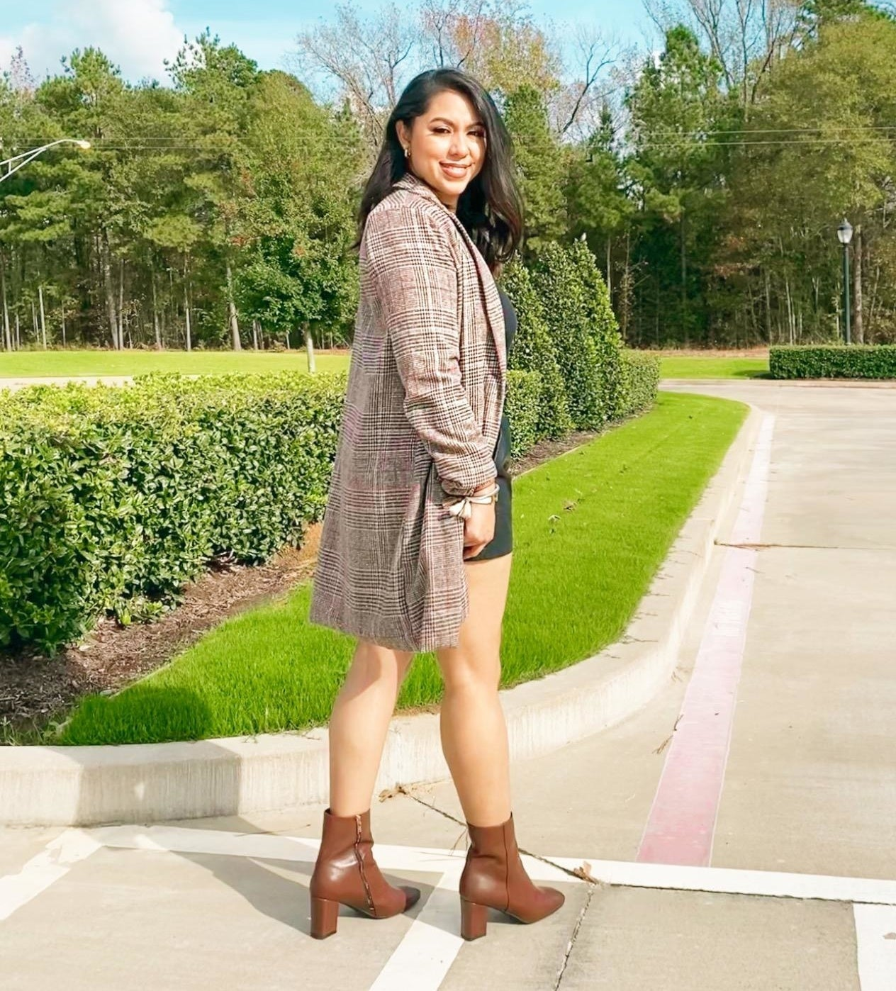 Reviewer wearing the brown plaid coat
