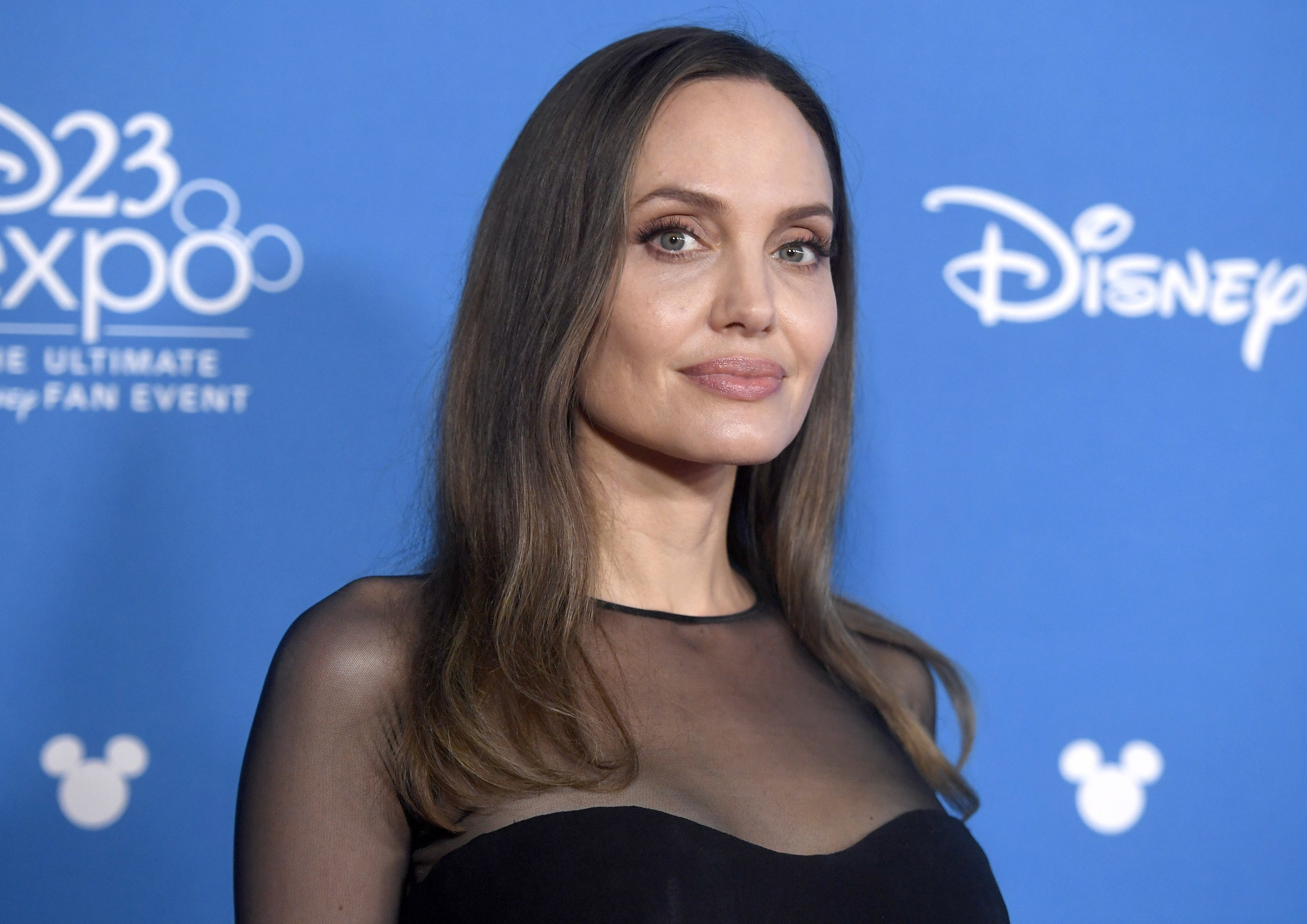 Angelina wears a sheer black top to an event