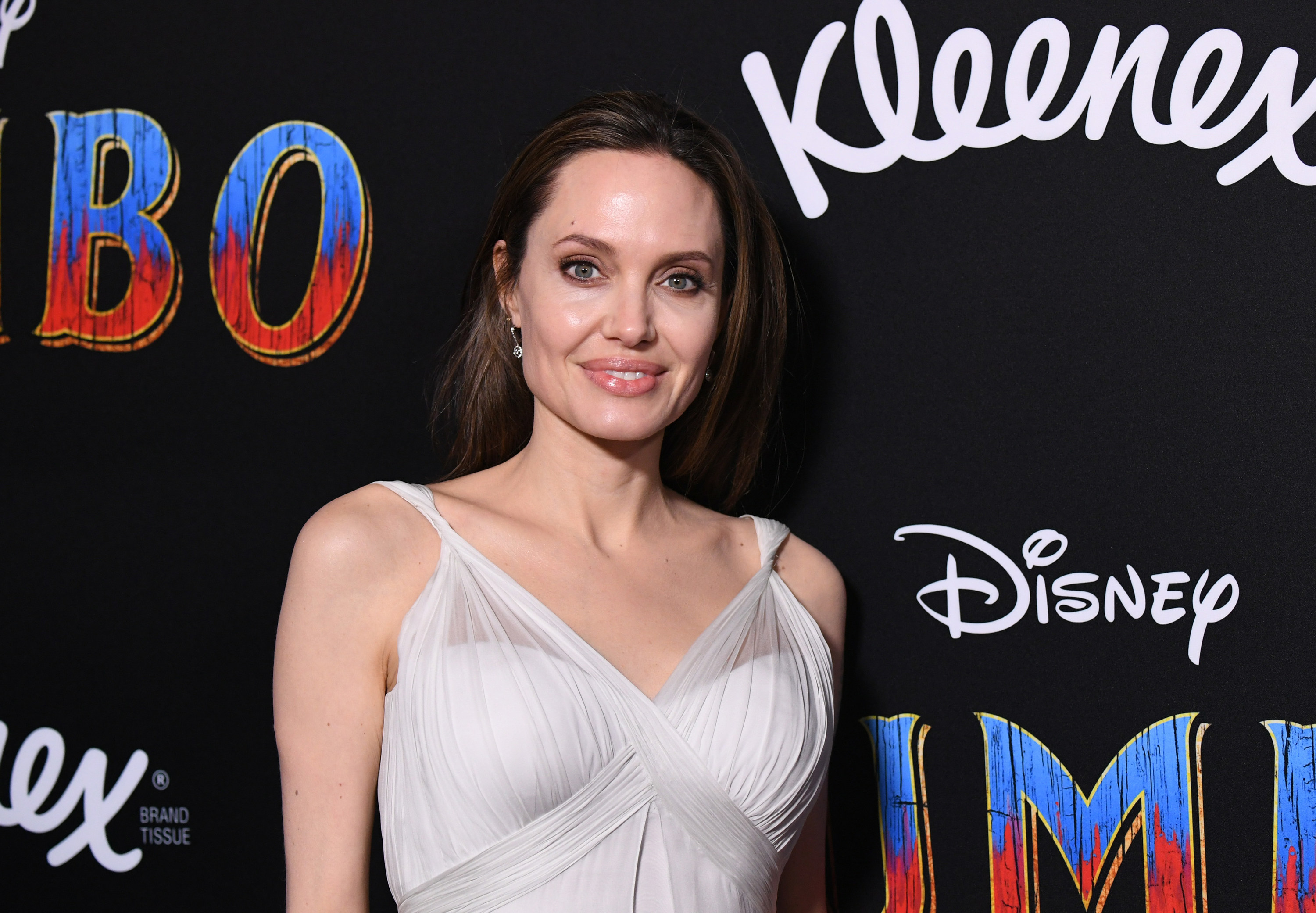 Angelina attends a premiere in a gown