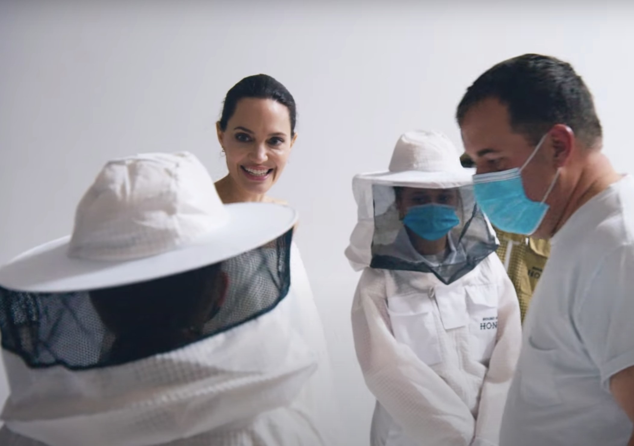 Angelina smiles at the beekeepers on set