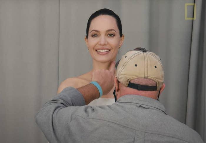 A man rubs the pheromone on Angelina