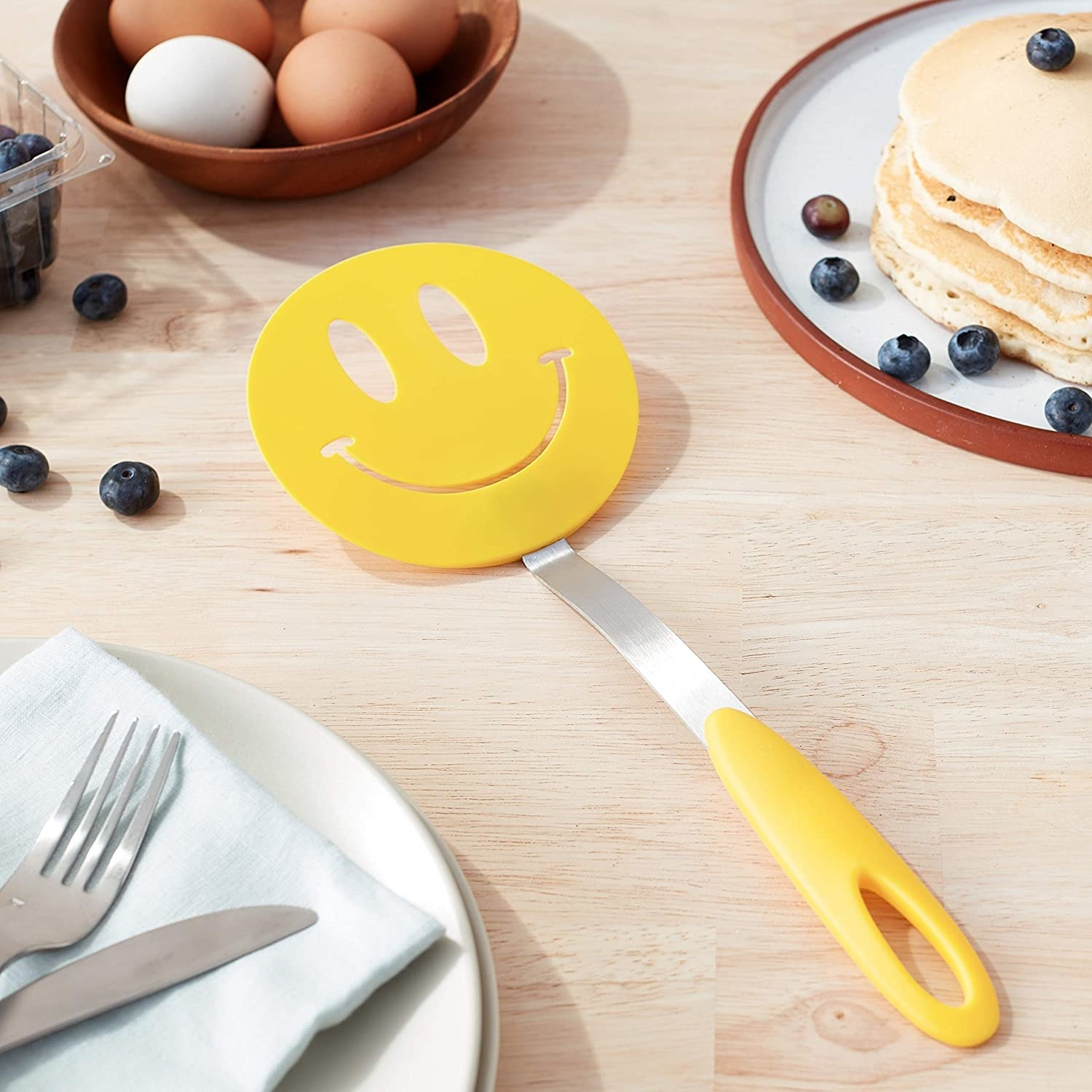 A spatula with a smiley face on the end
