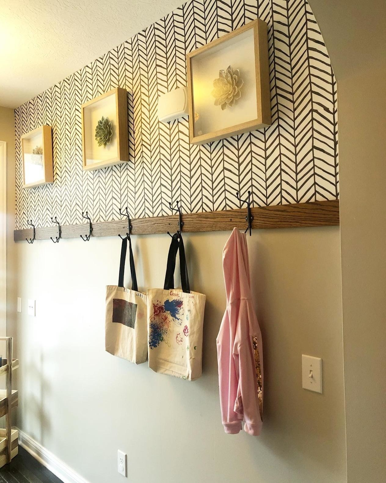 reviewer image of the herringbone peel and stick wallpaper on an entryway wall
