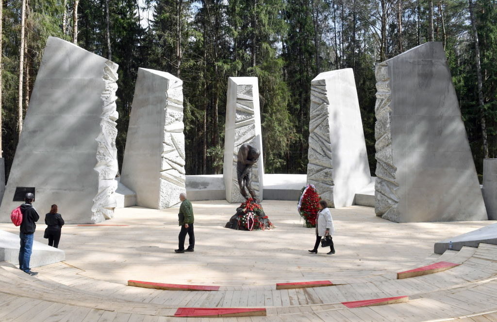 People visiting a memorial dedicated to the victims of the Katyn massacre