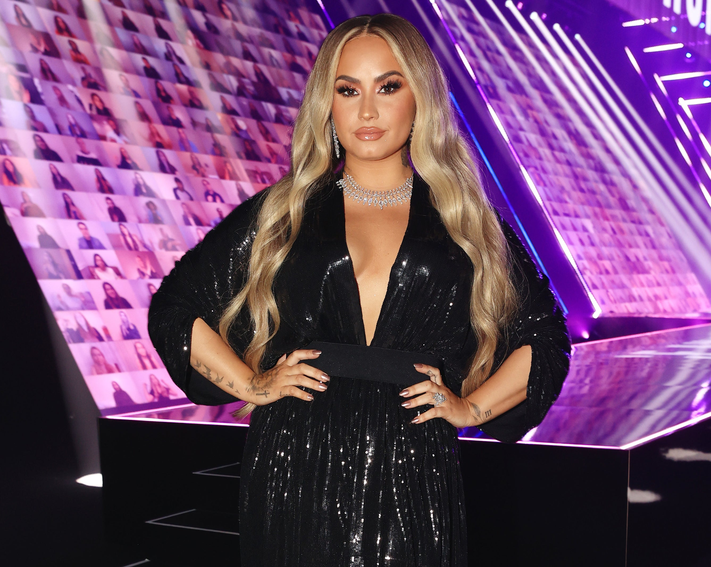 Demi wears a sparkling black dress
