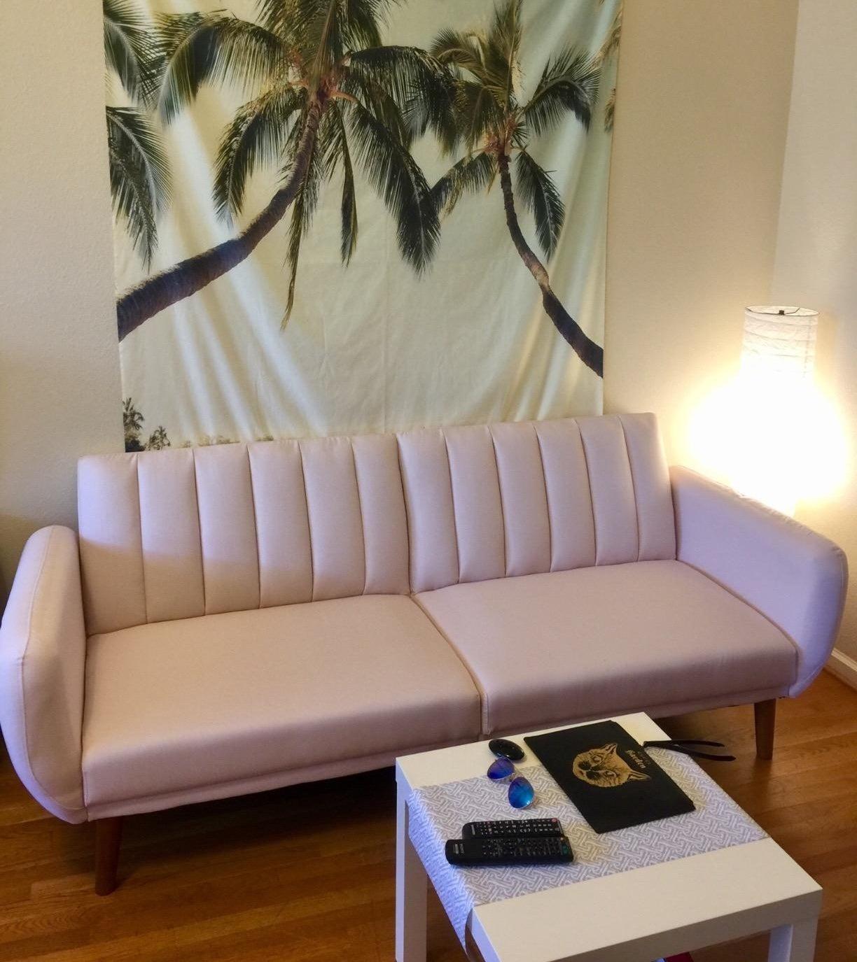 reviewer photo of a pink Novogratz futon