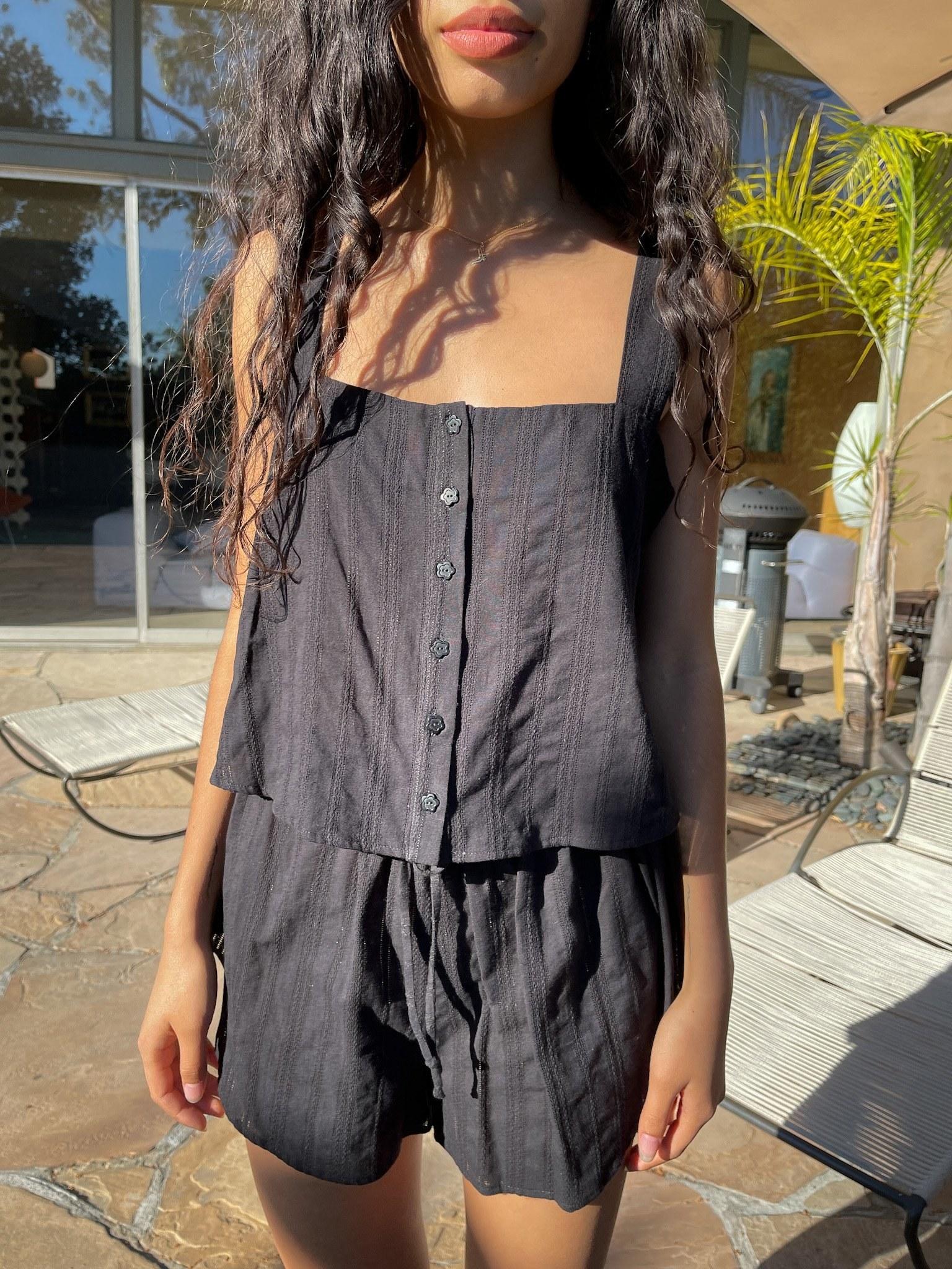 model wearing the black cotton set