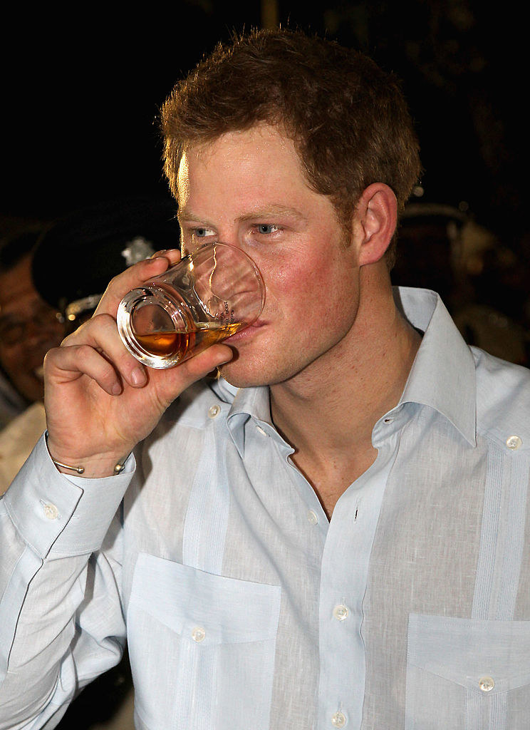 Prince Harry sipping a beer