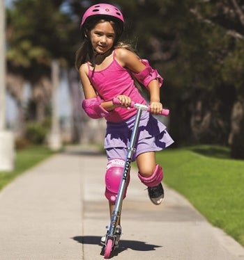 a child on a pink scooter