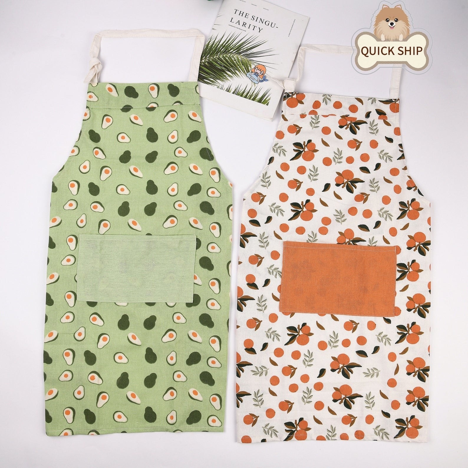 two aprons one green avocado and one orange
