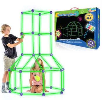 two children building a for with the poles and spheres