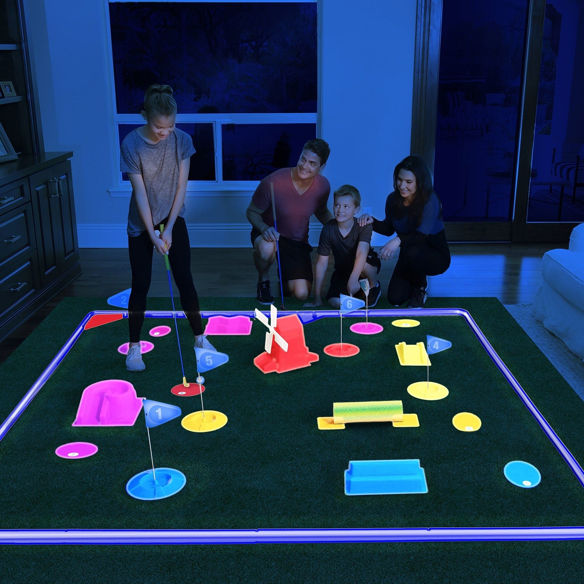 a family playing with the golf set in the dark indoors