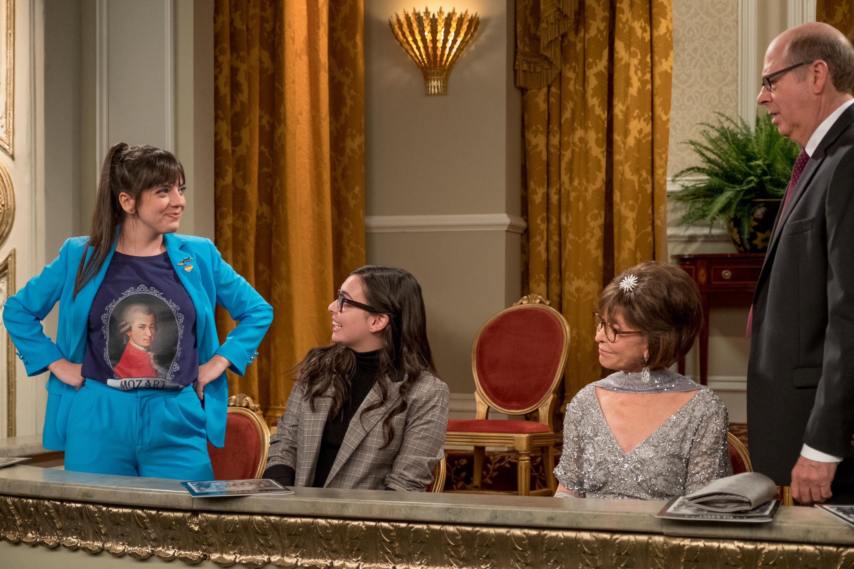 Isabella G omez, Rita Moreno, and Stephen Tobolowsky look at Sheridan Pierce's Mozart shirt.