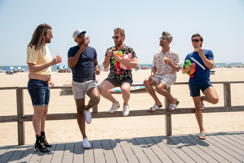 Jonathan Van Ness, Karamo Brown, Bobby Berk, Tan France, and Antoni Porowski on a boardwalk