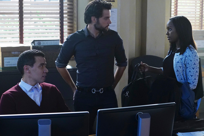 Conrad Ricamora, Jack Falahee, and Aja Naomi King by some computers