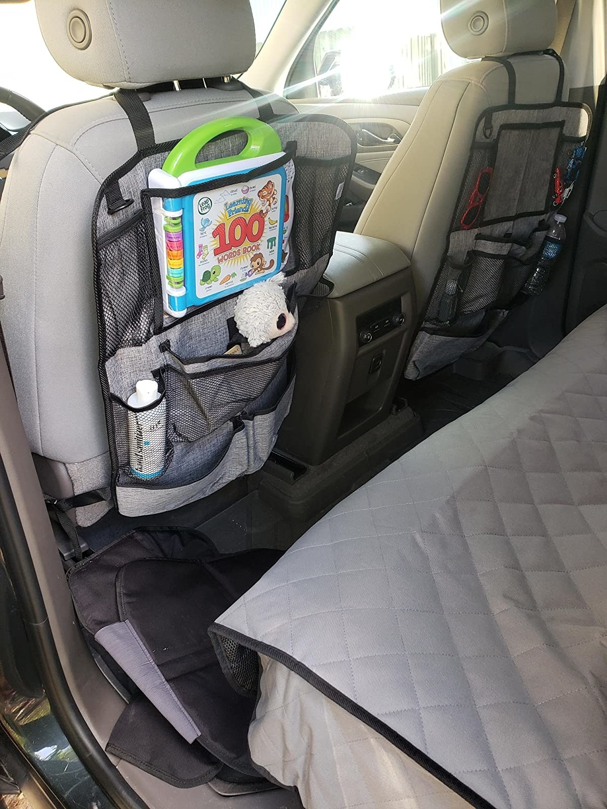 Reviewer photo of the organizers in a car holding baby supplies
