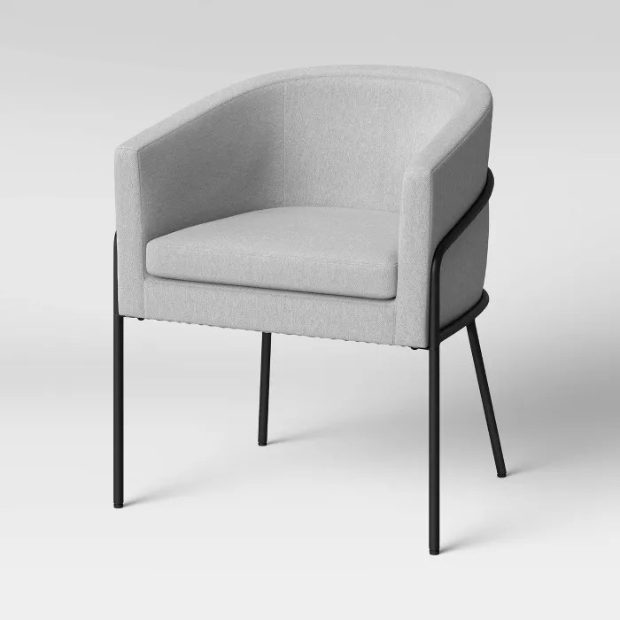 The gray chair with a black frame