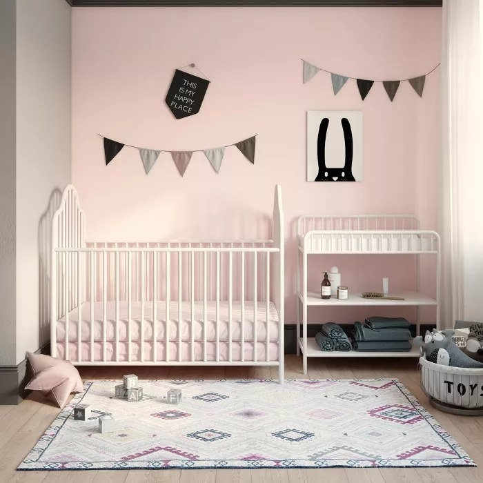 The white crib and matching changing table