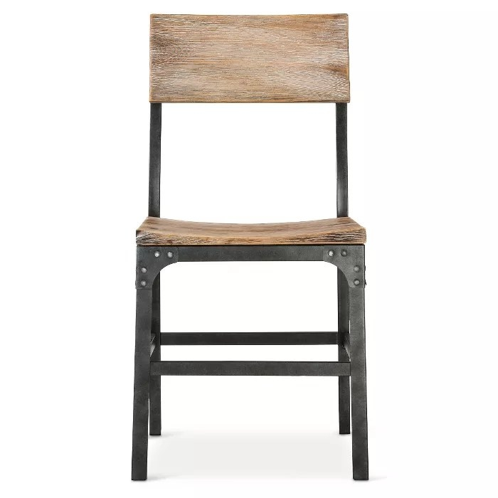The chair with a weathered finish and a steel frame