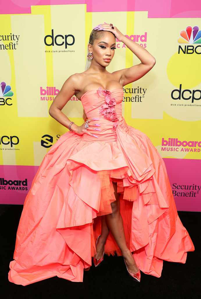 Saweetie poses backstage for the 2021 Billboard Music Awards
