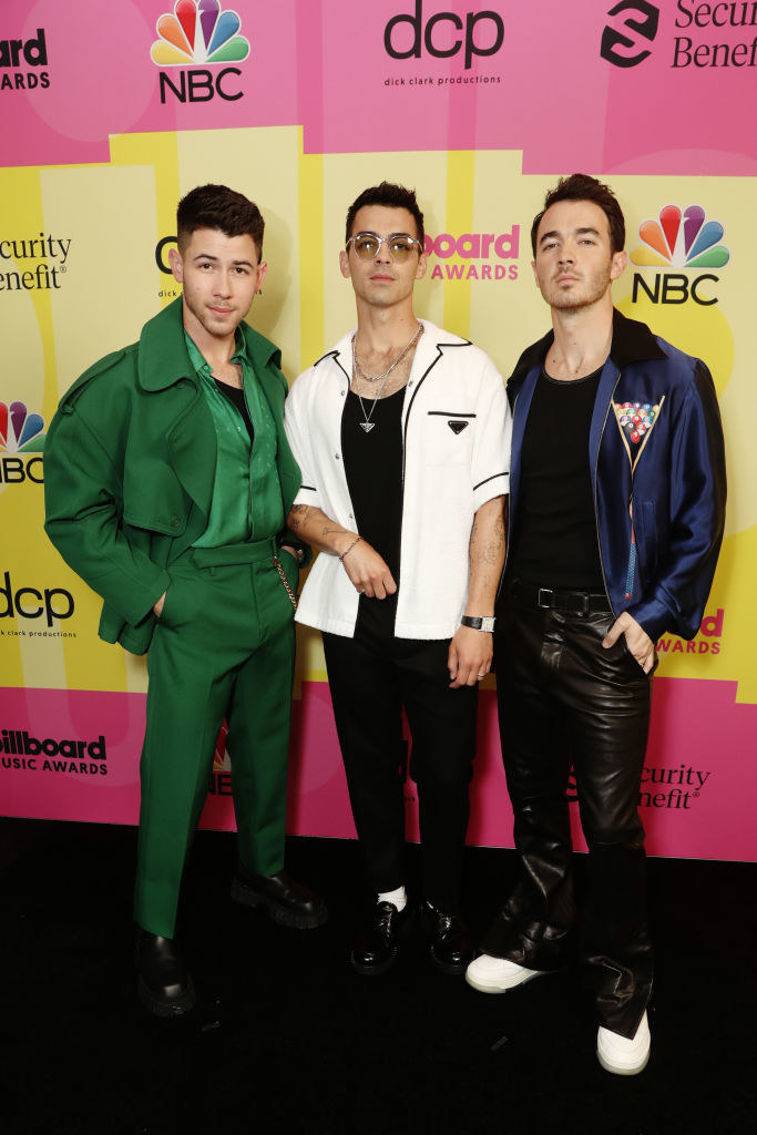 (L to R) Nick Jonas, Joe Jonas, and Kevin Jonas of Jonas Brothers arrive to the 2021 Billboard Music Awards