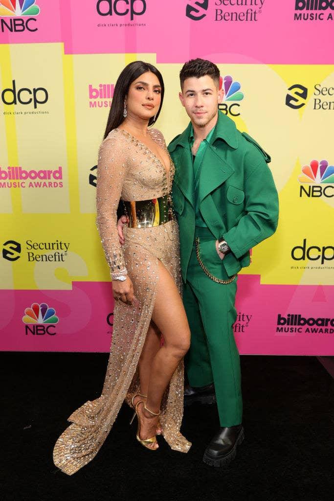 (L-R) Priyanka Chopra Jonas and Nick Jonas pose backstage for the 2021 Billboard Music Awards