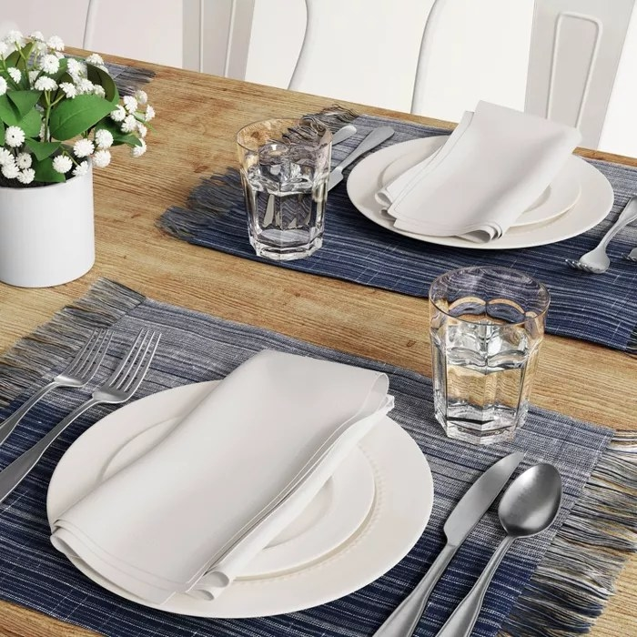 The blue placemats with tassels