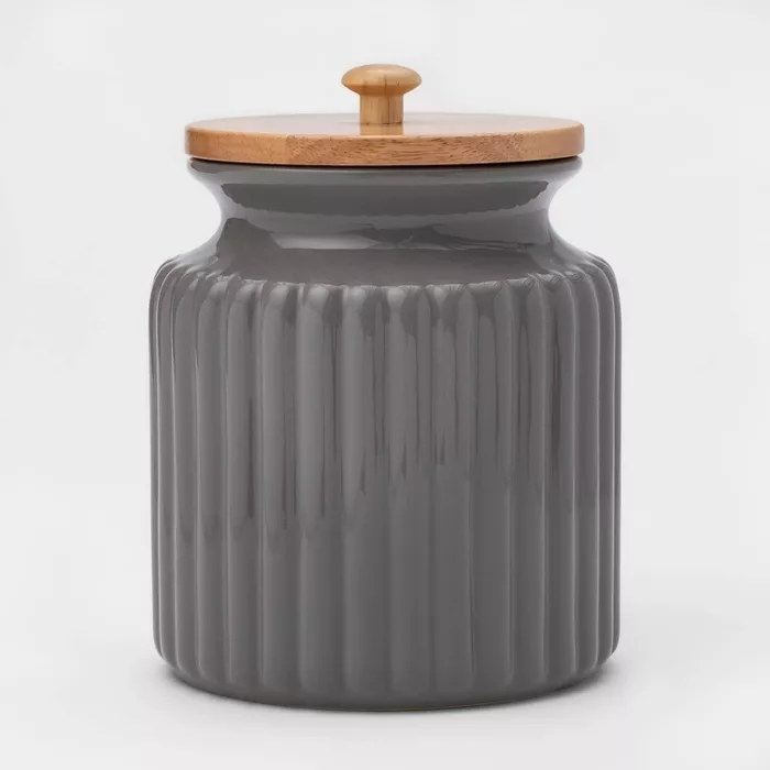 The gray container with a wood lid