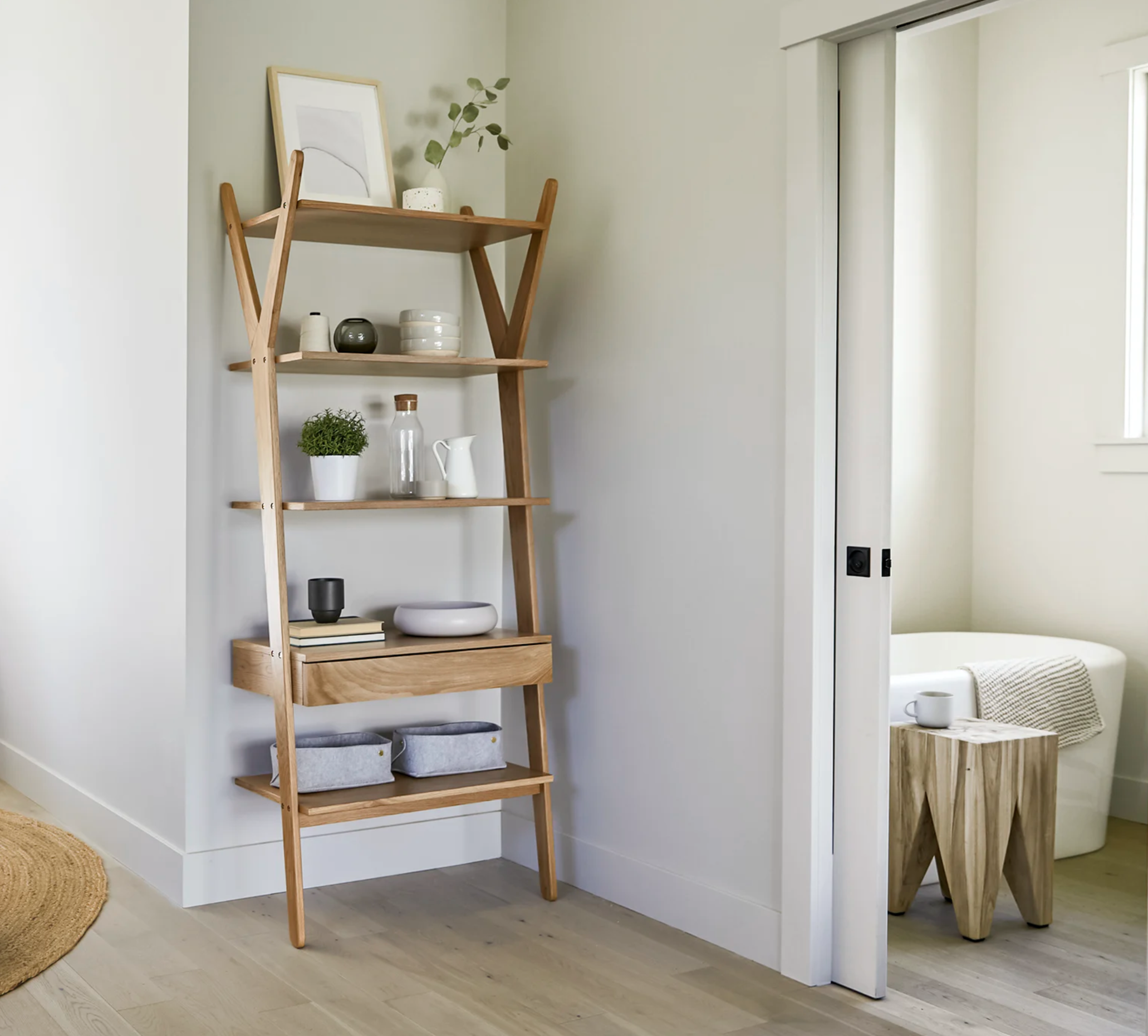 the five-tier shelf leaning against a wall