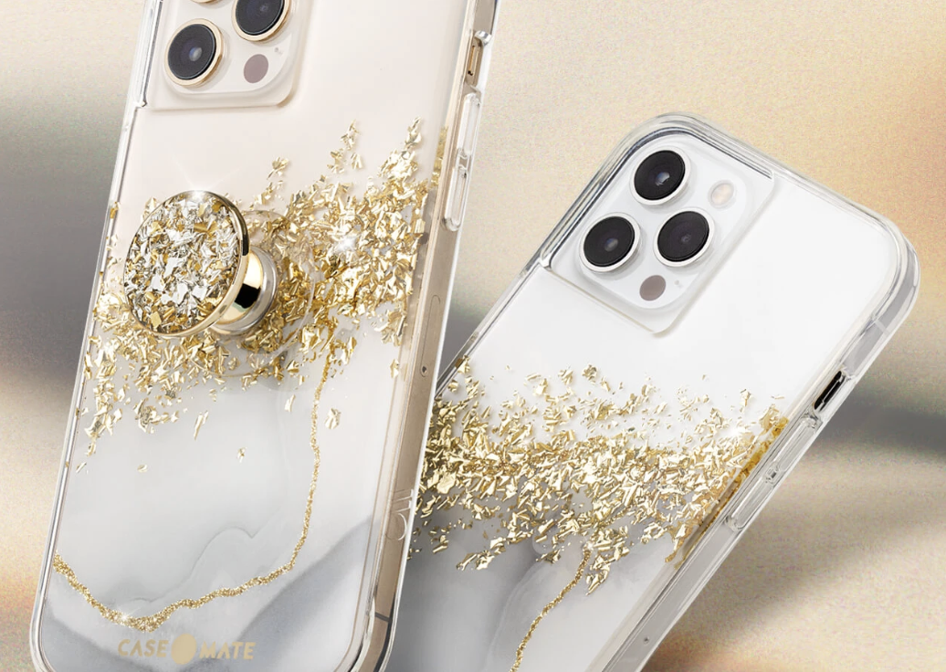 A white marble patterned phone case with gold foil detailing on an iPhone
